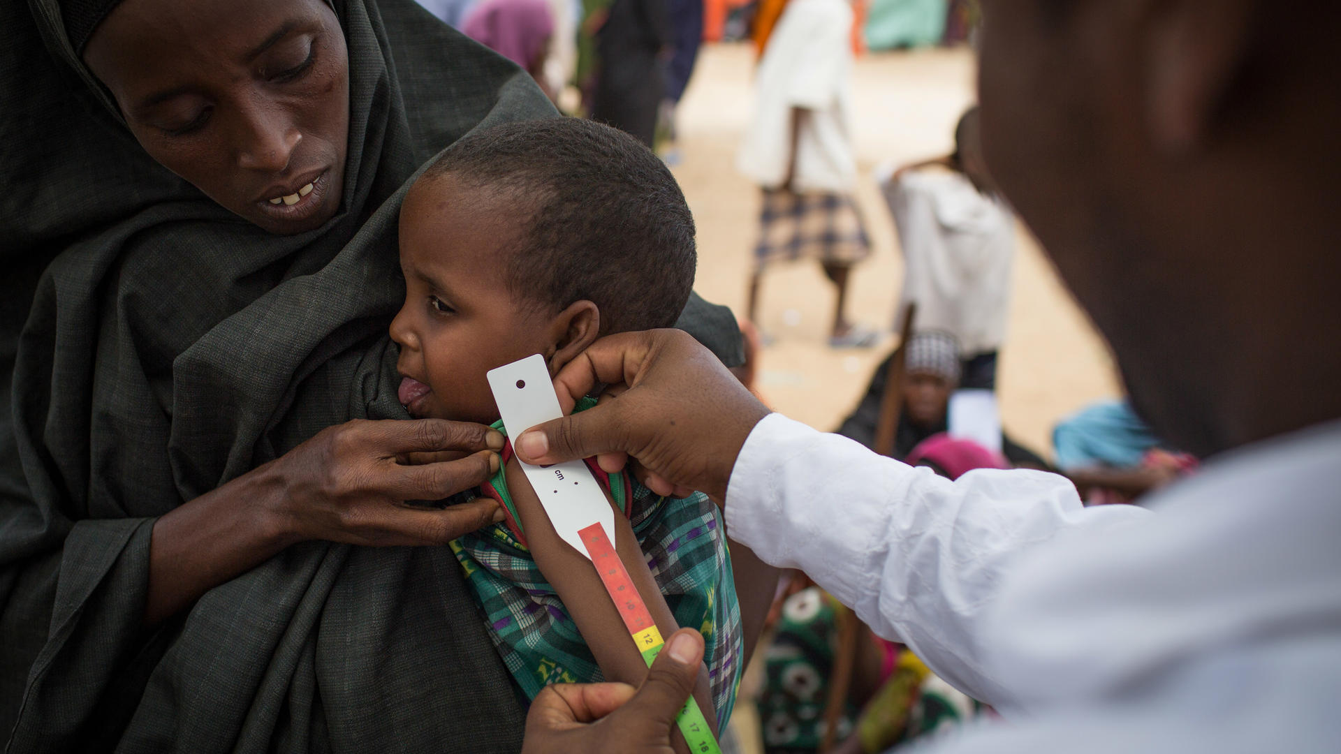 A child is screened for malnutrition at an IRC clinic in a camp near Mogadishu, Somalia