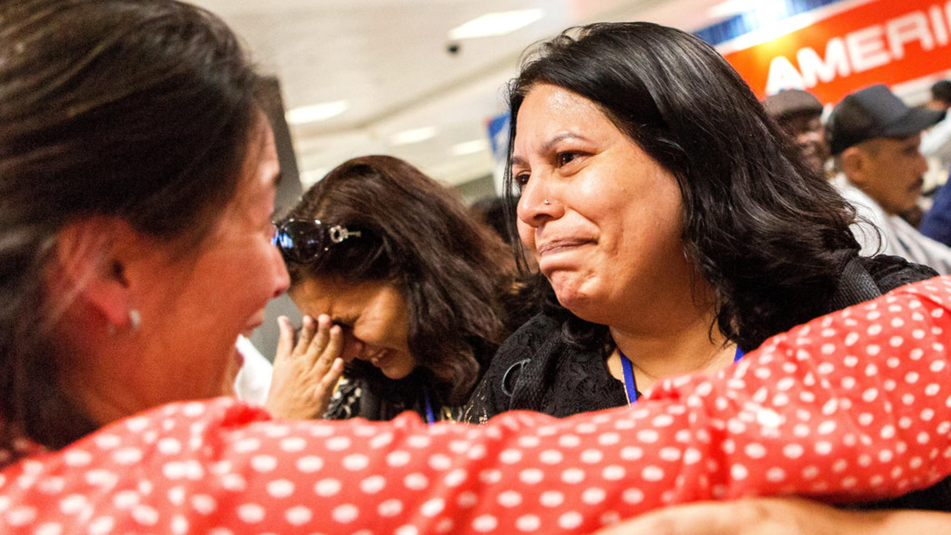 IRC staffer Kristin welcomes Shaista Sadiq at Dulles airport with a hug