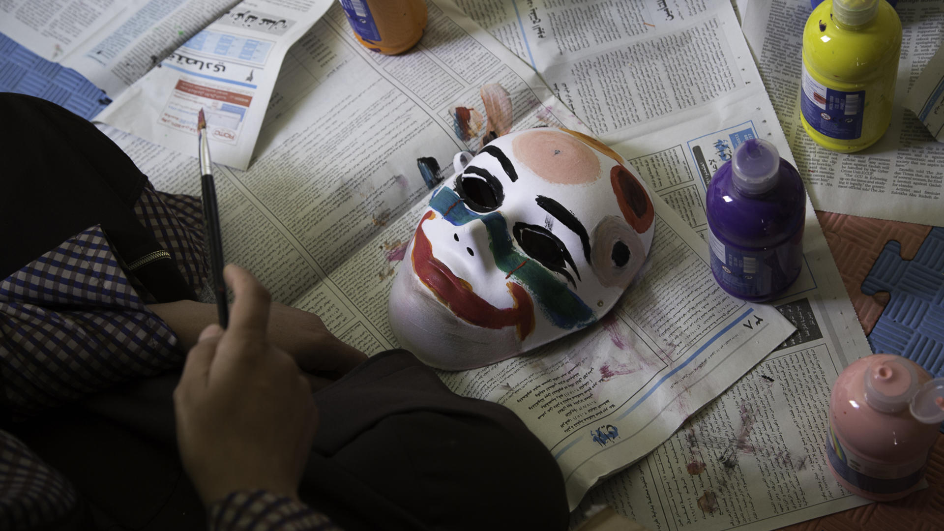 A mask painted by a Syrian child living in a refugee camp in Jordan.