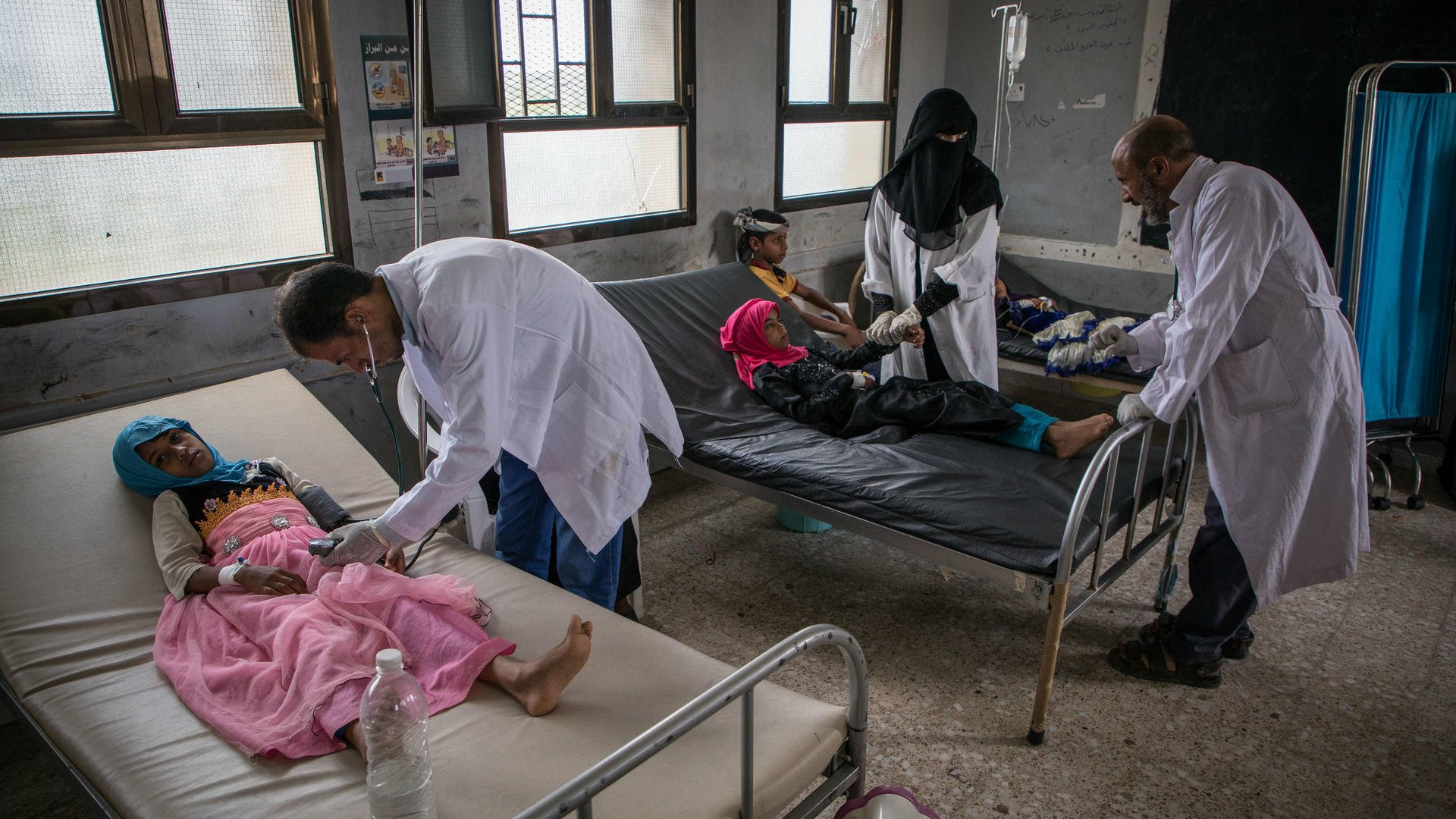 Doctors care for children who are patients at an IRC diarrhea treatment center in Yemen