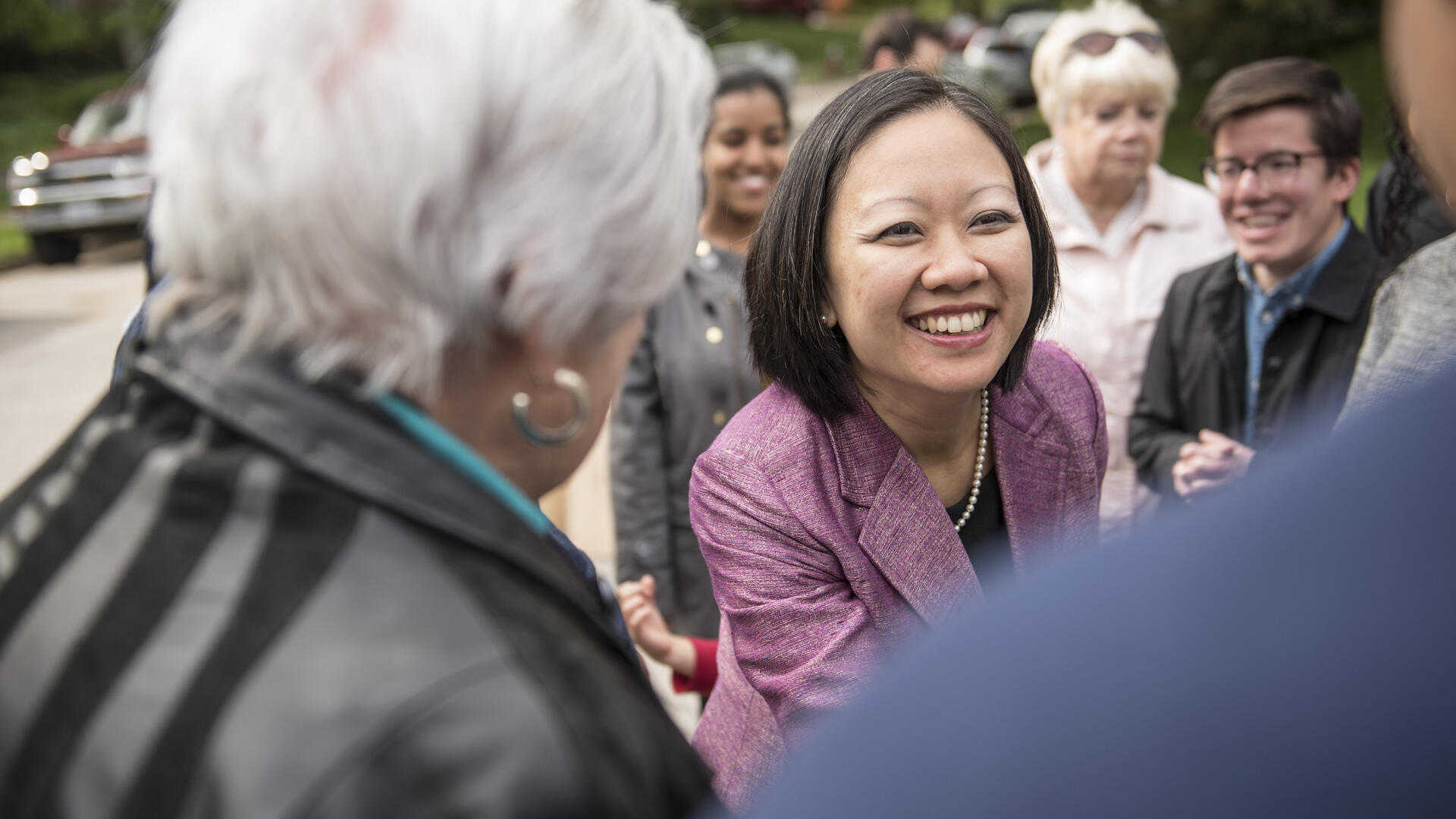 Kathy Tran shakes hands with voters while campaigning for a seat in the Virginia State House