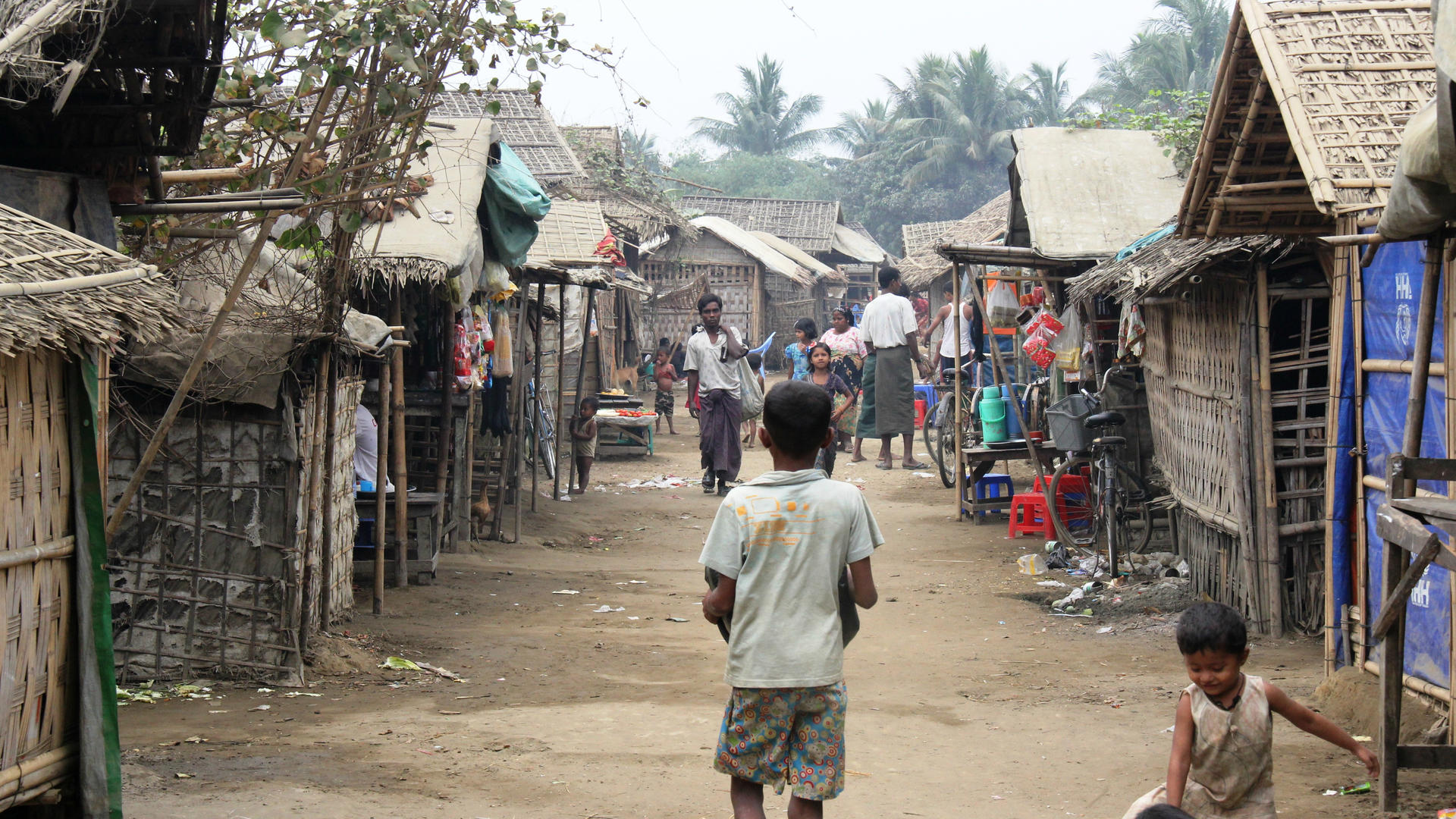 A boy walks through a camp for Muslims displaced by violence in Rakhine state, Myanmar