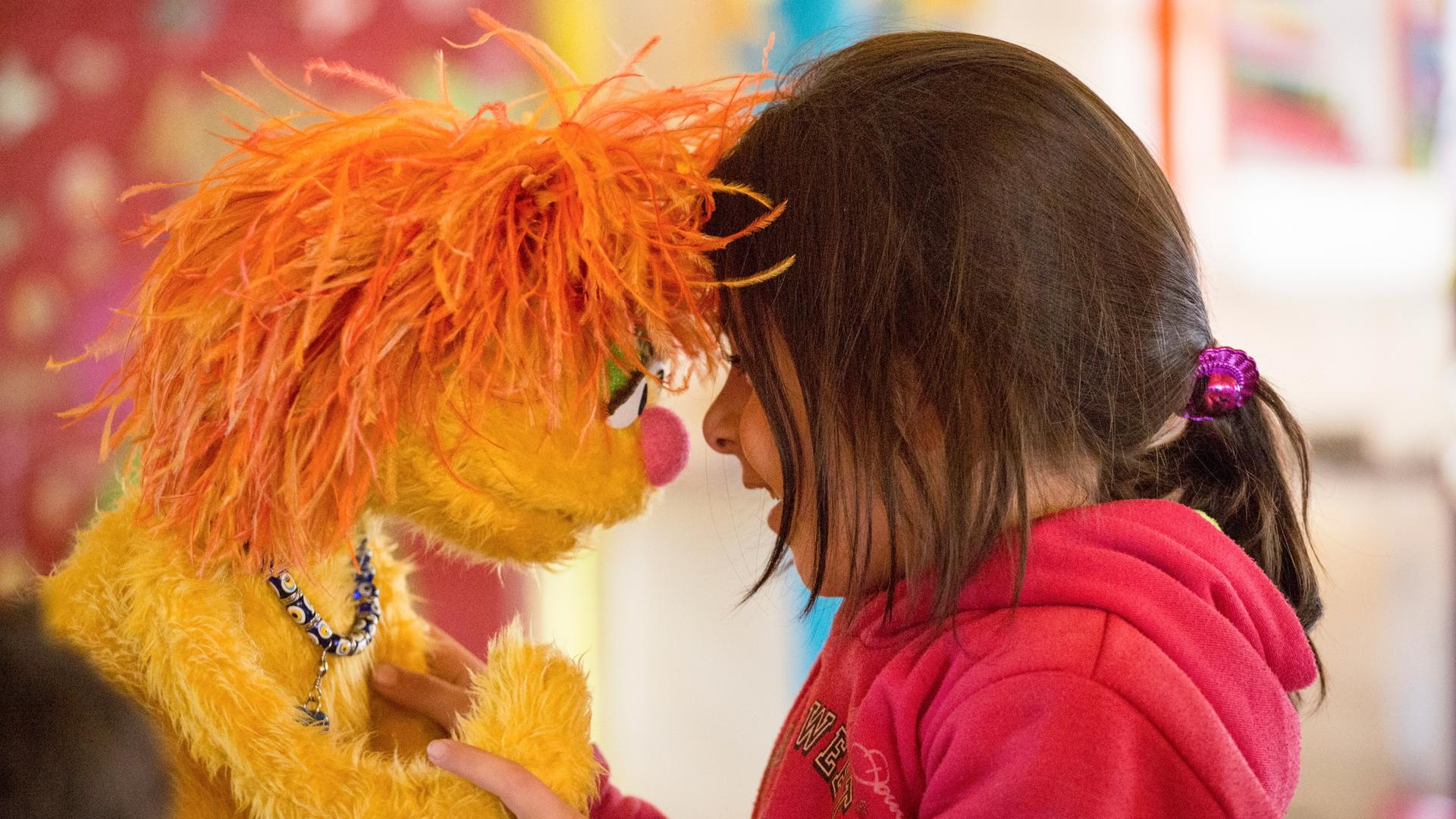 Syrian girl with Sesame Muppet Tonton