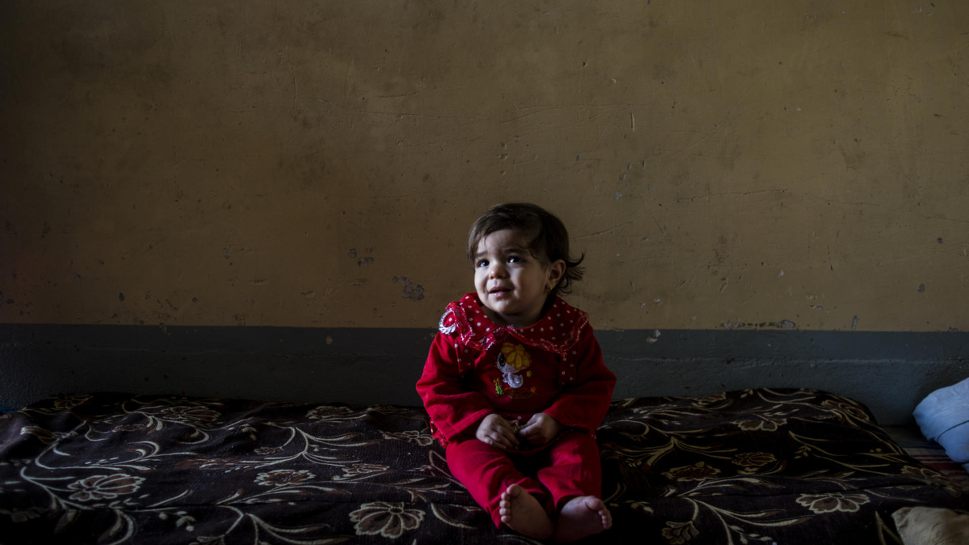 A toddler at home in east Mosul
