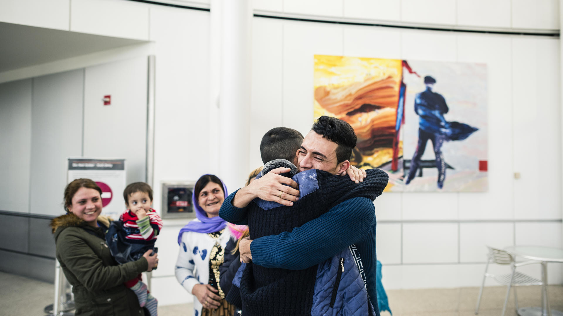 Adil Nimr, a refugee from Iraq who escaped ISIS, was reunited with 13 family members in Seattle on Feb. 10 after President Trump's travel ban was blocked.