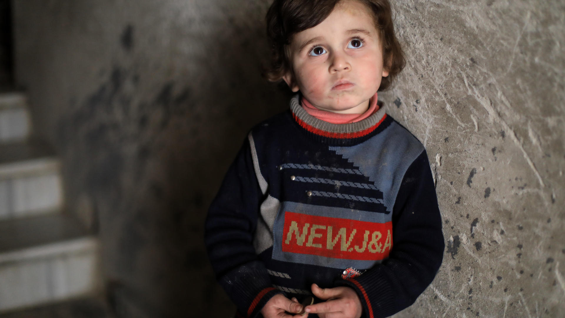 Syrian boy outside his home in Douma