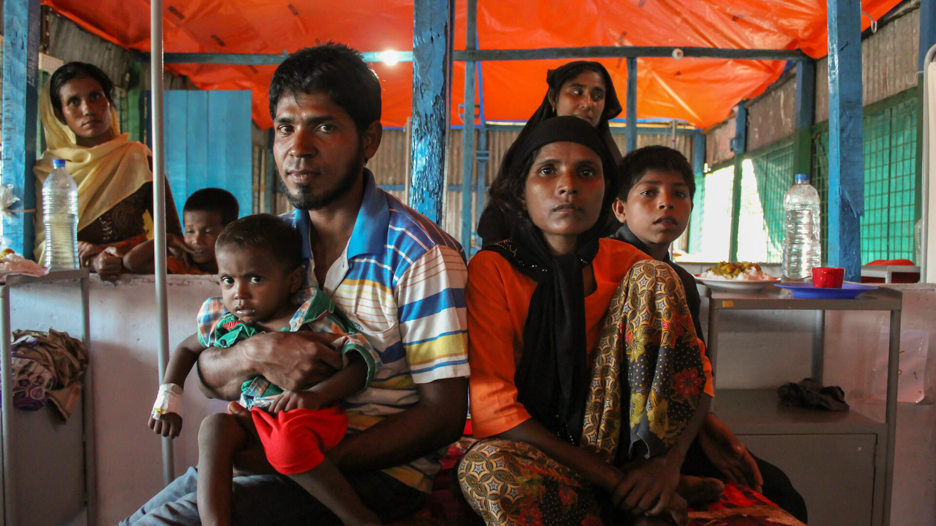 A Rohingya family with their children at an IRC-supported health center in Cox's Bazar, Bangladesh