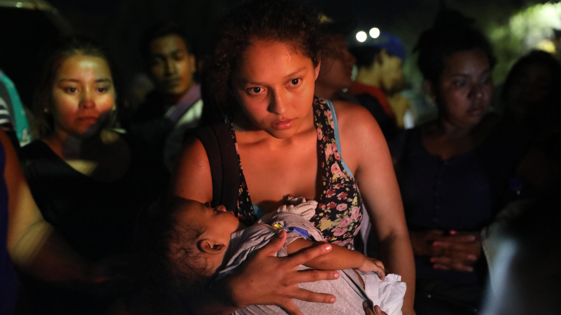 Central American asylum seekers wait for buses to take them to Tijuana on the U.S.-Mexico border. Photo: Getty Images