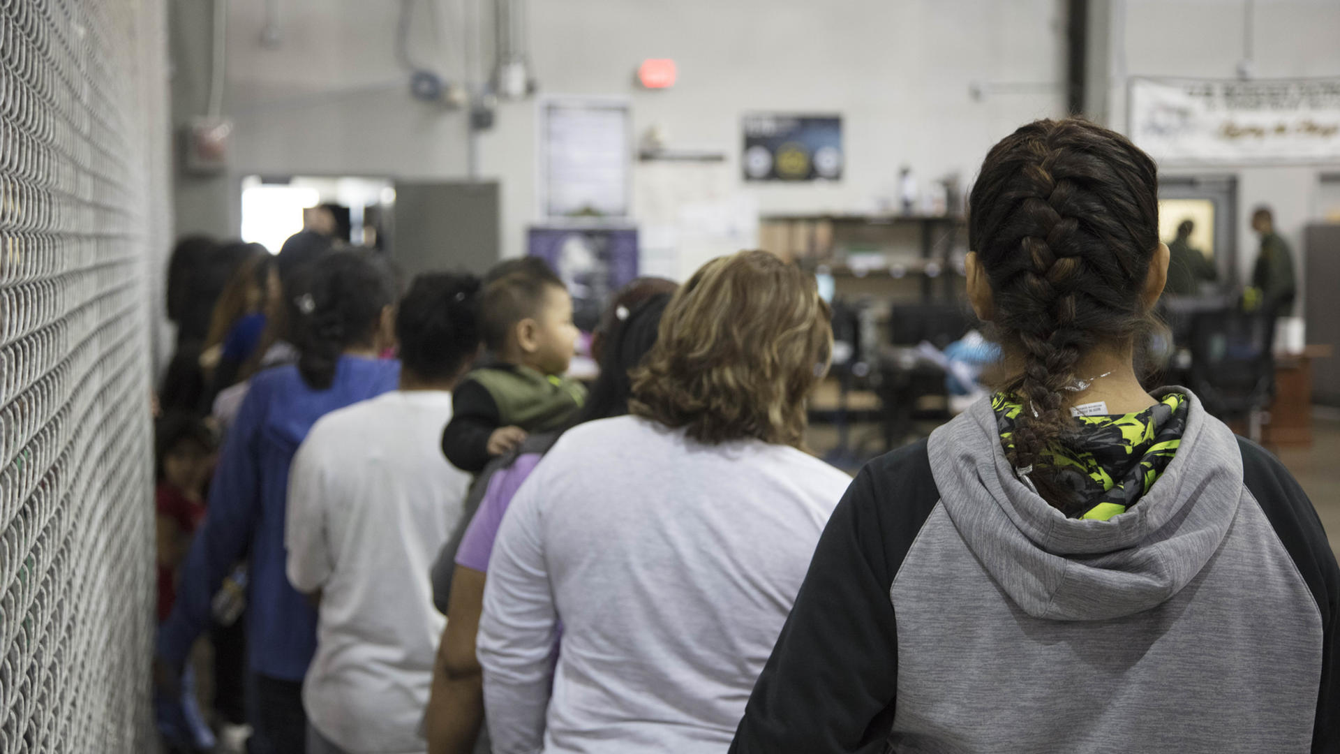 Women and children wait in line to be processed at a U.S. Border Patrol facility in Texas