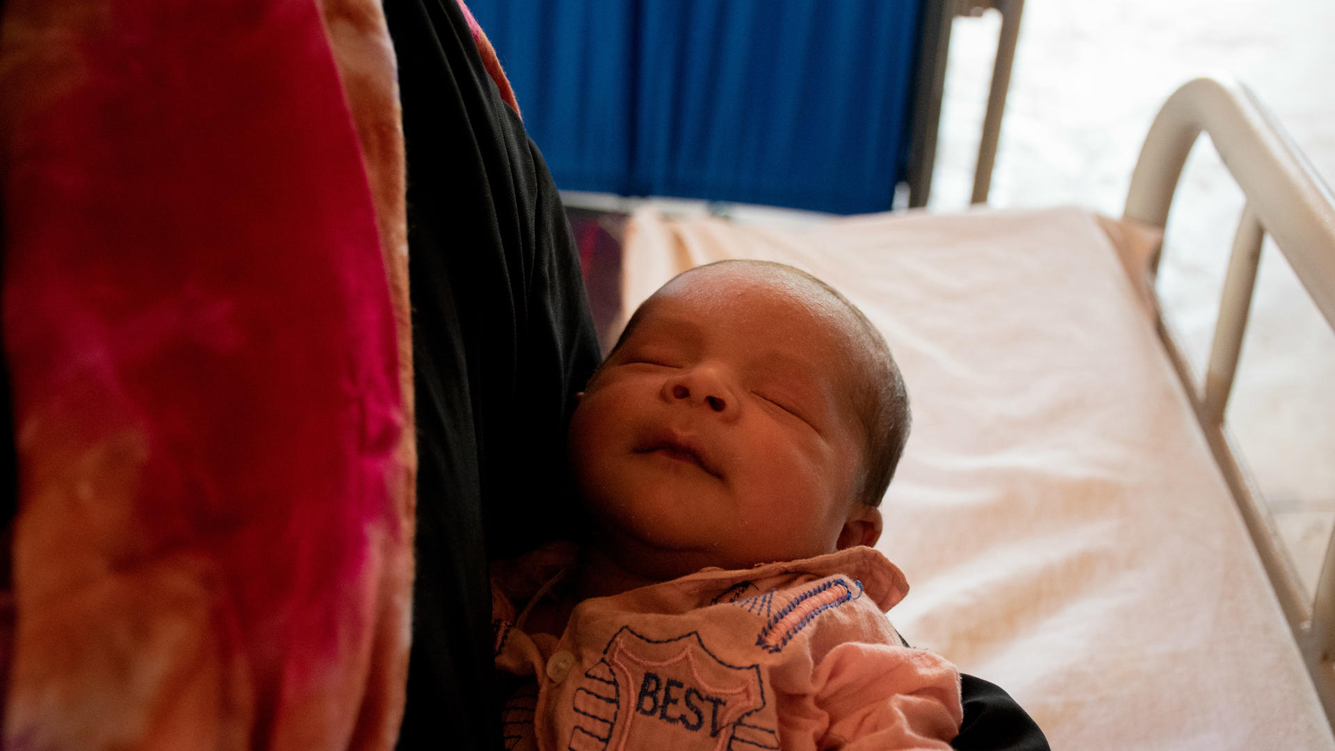A newborn Rohingya boy in his mother's arms
