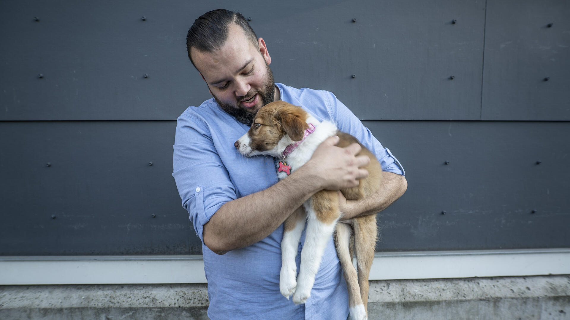 Suamhirs Piraino-Guzman with his dog, Lilly, outside his home in Seattle