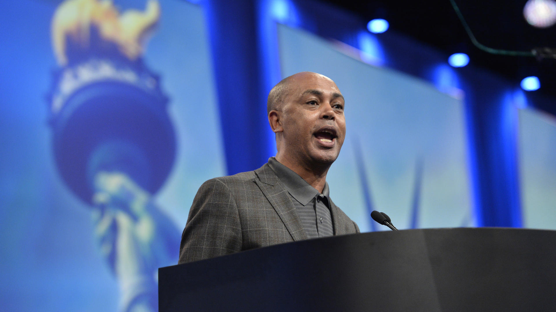 Tefere Gebre speaks at a podium at an AFL-CIO event
