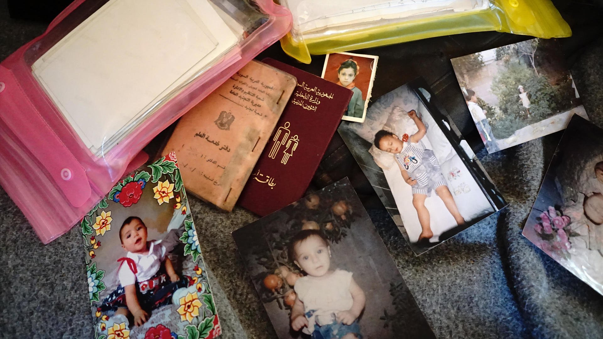 refugees' passports and family photos