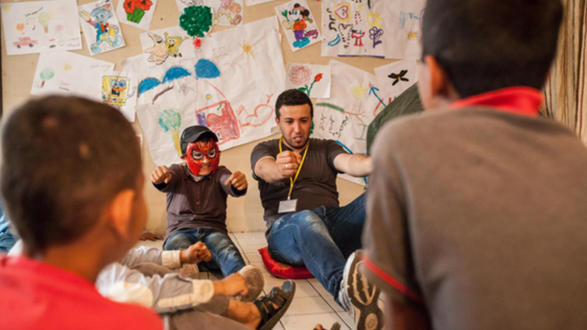 Syrian refugee boys in Beirut play at IRC play space