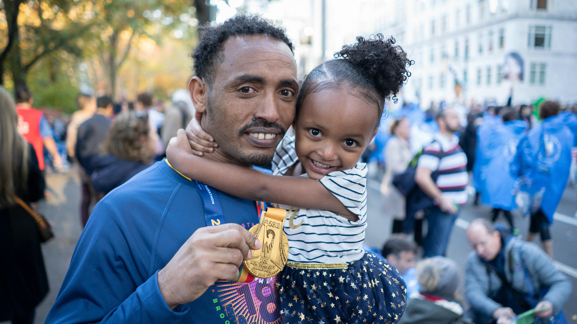 Ethiopian runner Tolassa Elemaa with his daughter after completing the New York City Marathon on Nov. 7, 2018