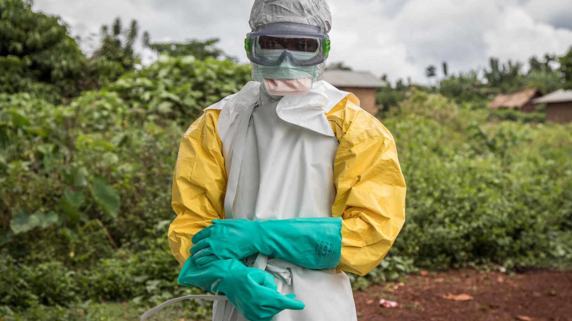A health worker in the Democratic Republic of Congo stands in full personal protective gear (PPE)
