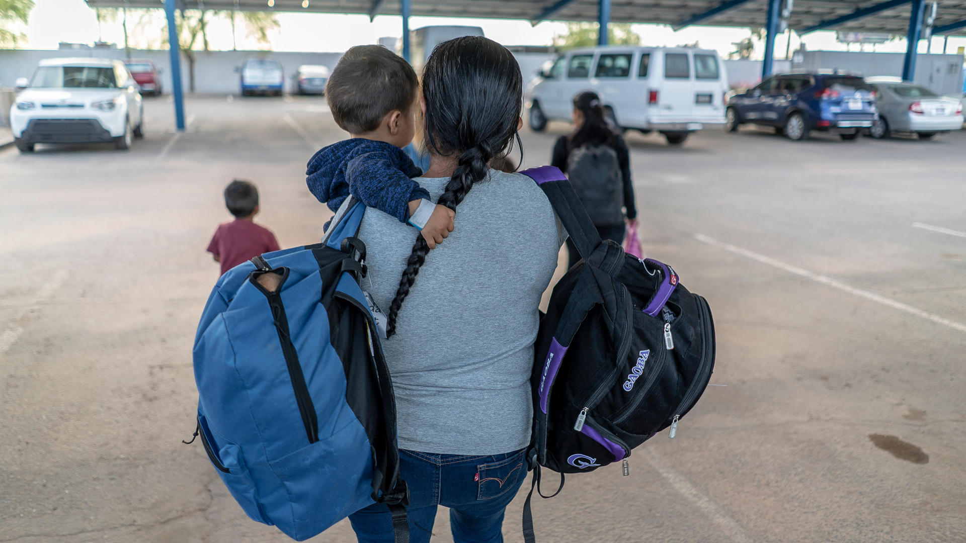 Central American mother with her child after being released from detention