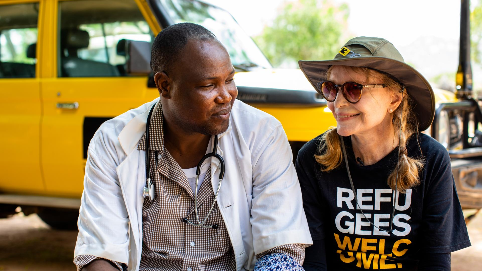Mia Farrow sits talking with Bebnone Dominique, head of the Mangalme' Health Center where the International Rescue Committee works in the Guera region of Chad