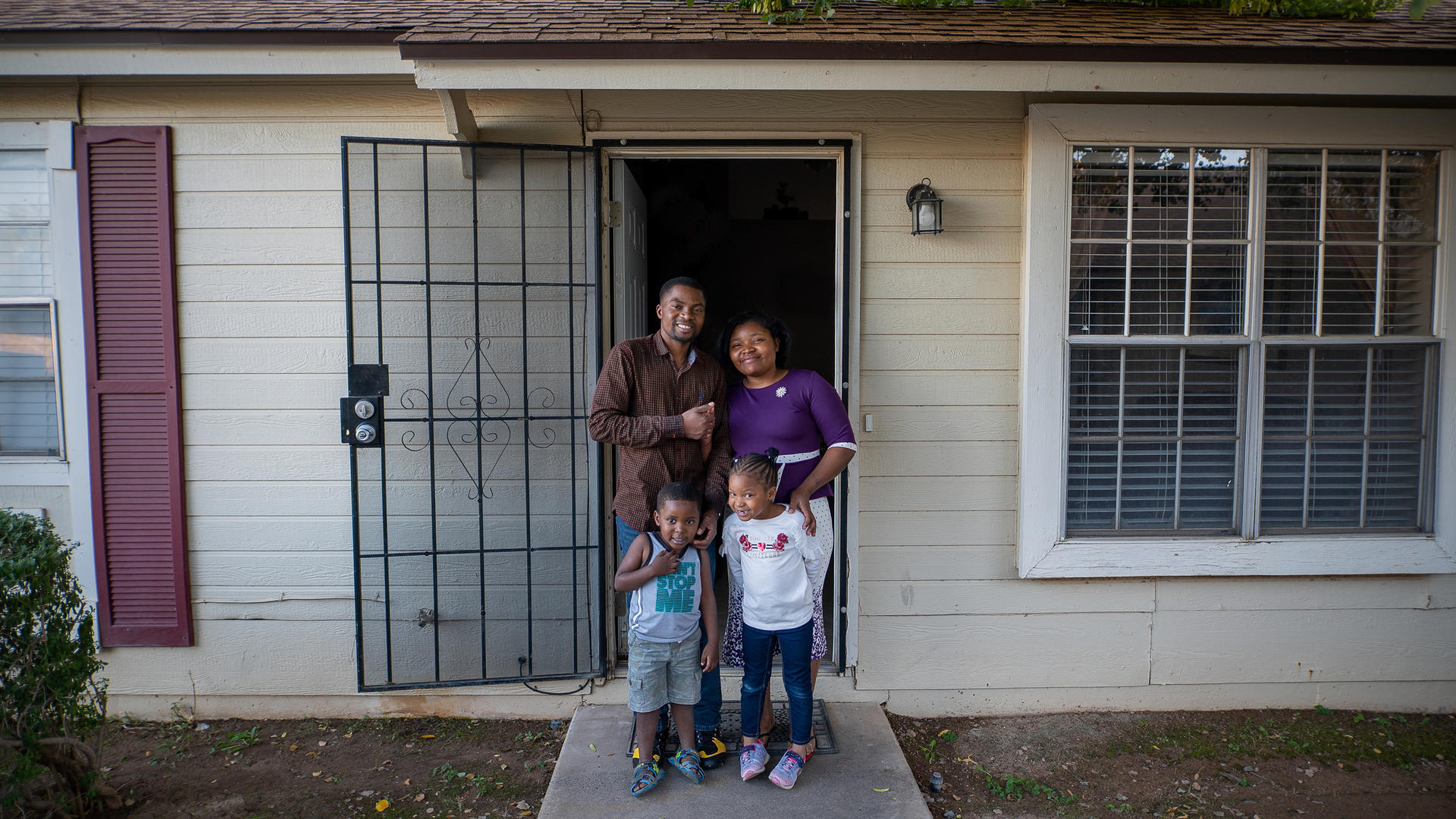 Congolese refugee family outside home in Arizona