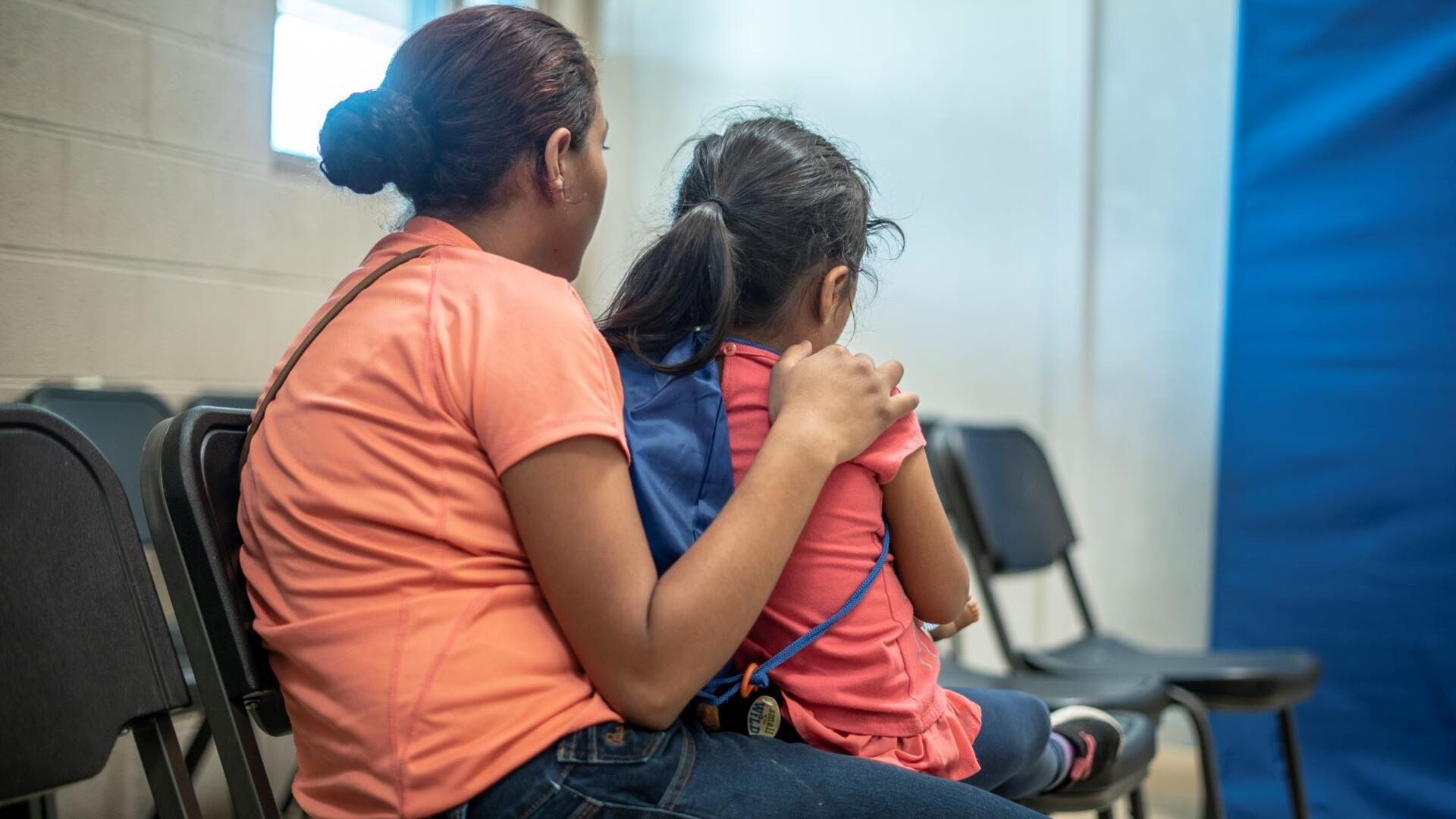 Emilia, 21, holds her 4-year-old daughter at the shelter in Phoenix where the IRC welcomed them after they were detained while fleeing to the U.S. from Honduras.