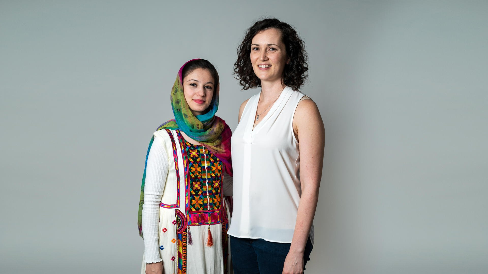 Muska, left, from Afghanistan with her friend Mary.