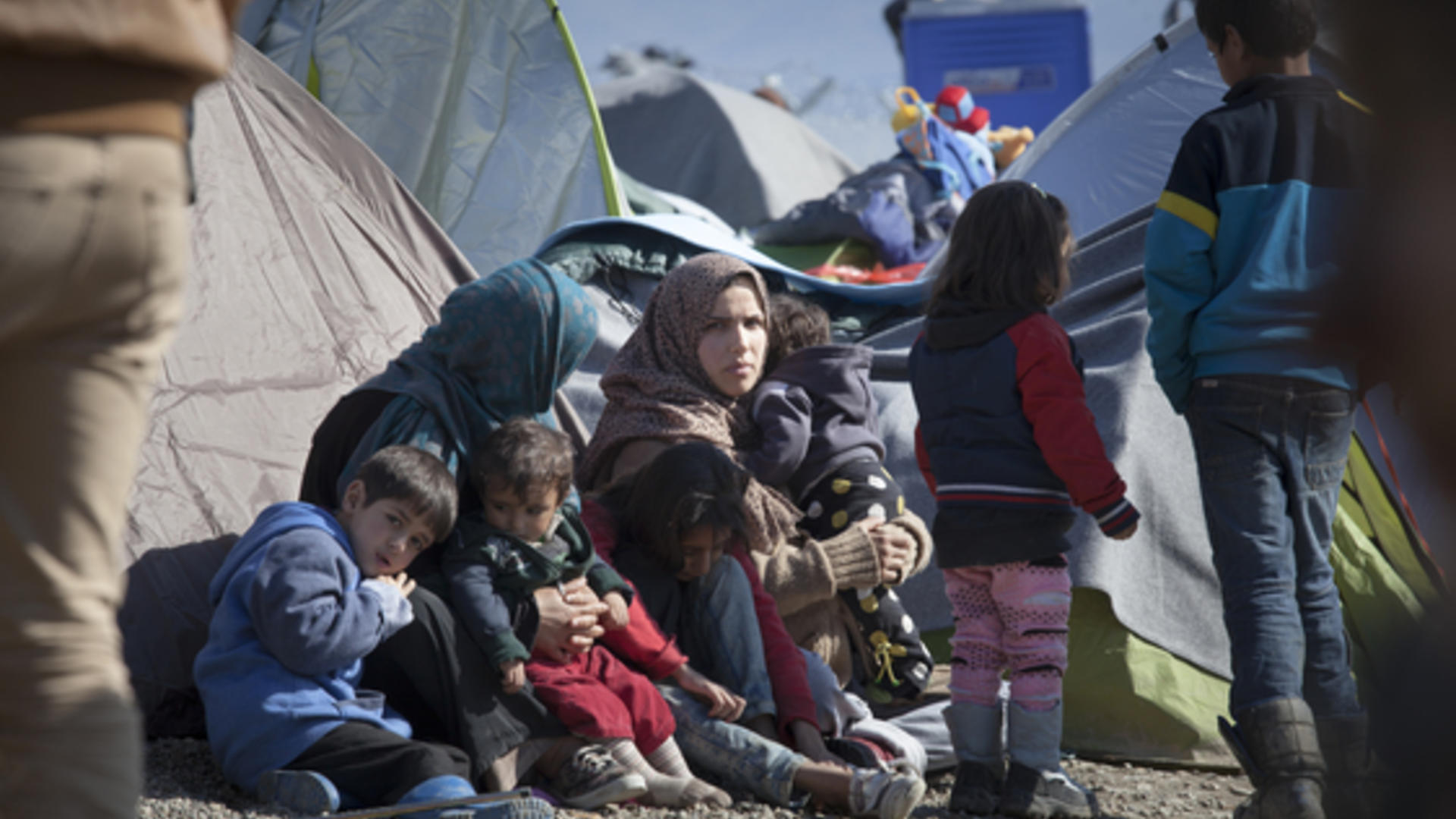 A refugee family find temporary shelter in a camp in Greece. Photo taken by Jodi Hilton for the IRC.