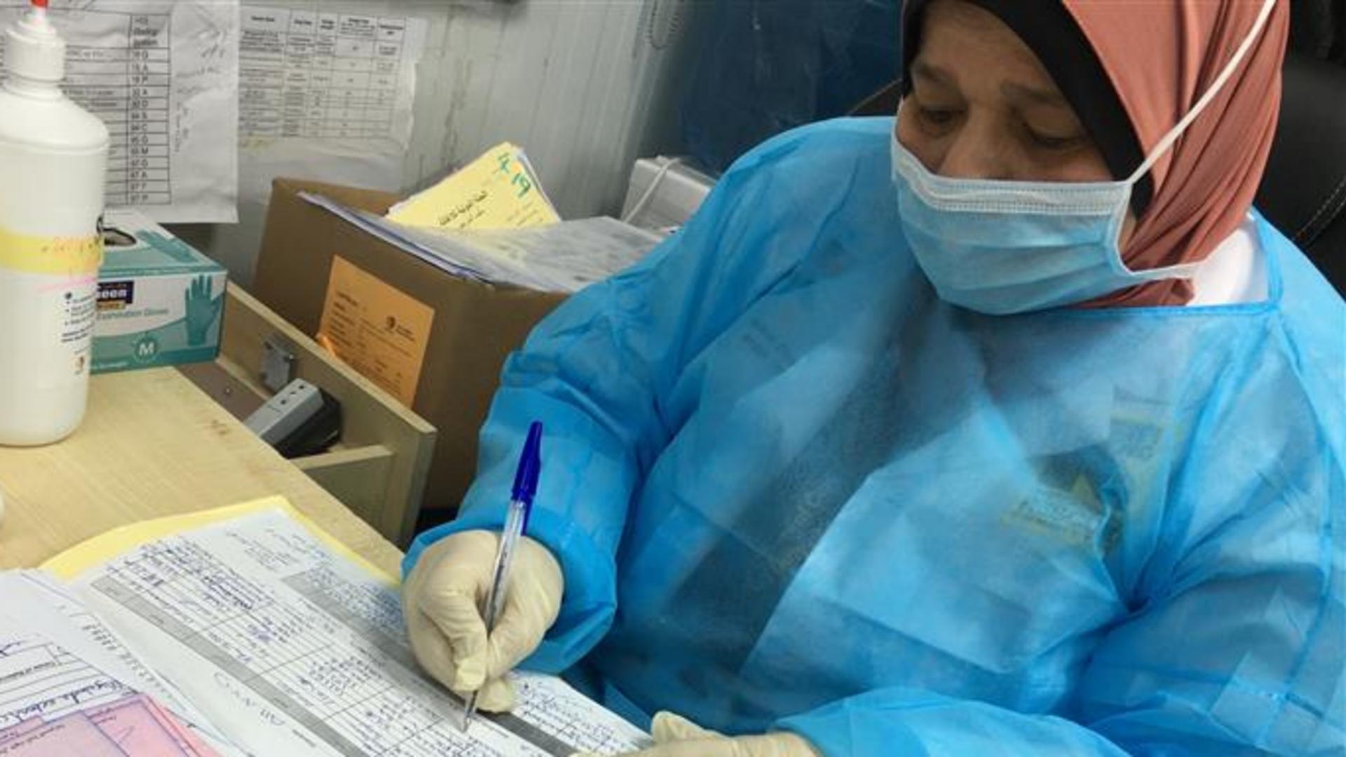 An IRC staff member in Jordan looks over paperwork.