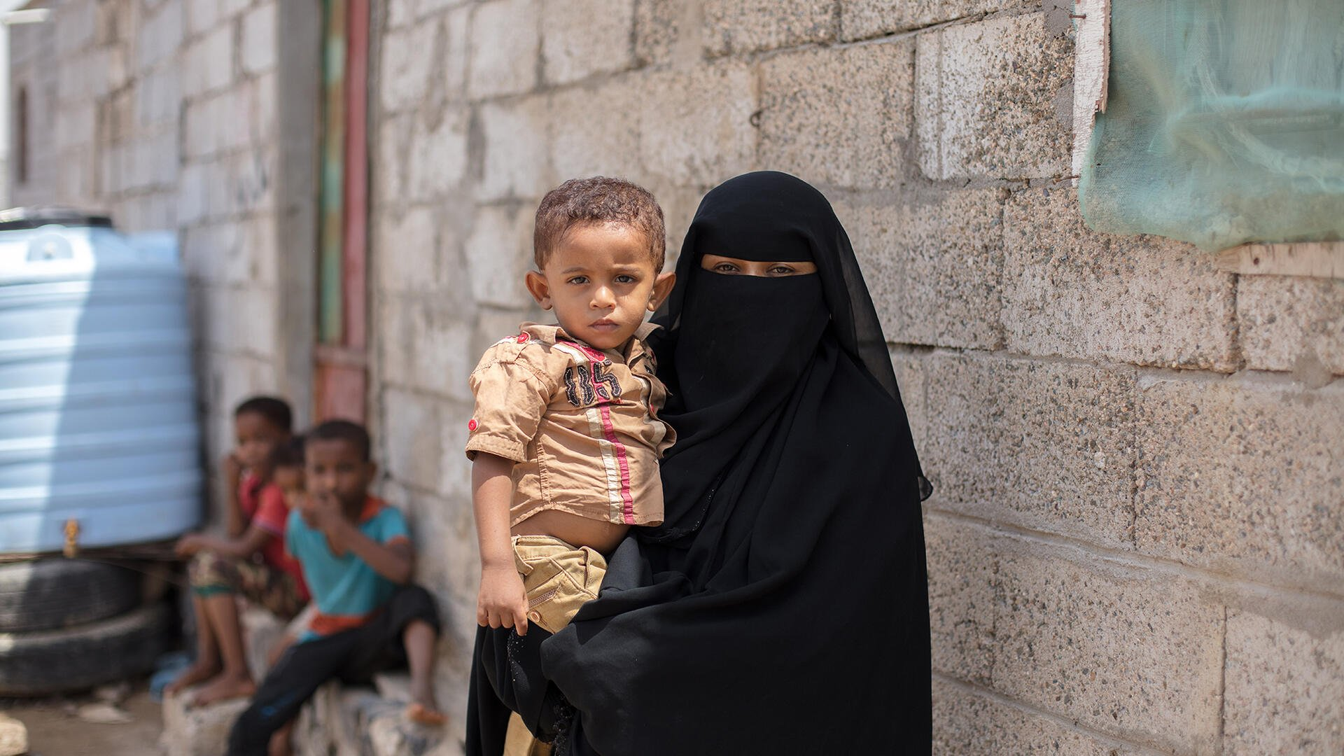 A Yemeni mother holds her young son.