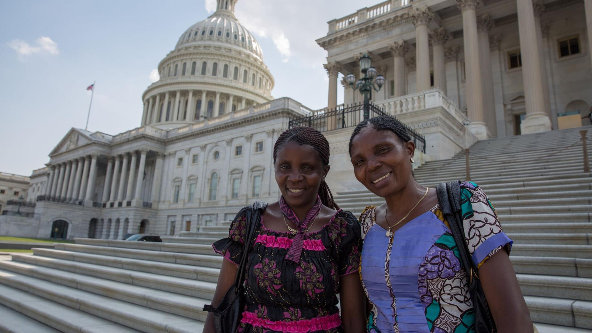 Two female women's rights activists from the Democratic Republic of Congo stand on the steps of the U.S. Capitol on a visit to Washington, DC in 2016