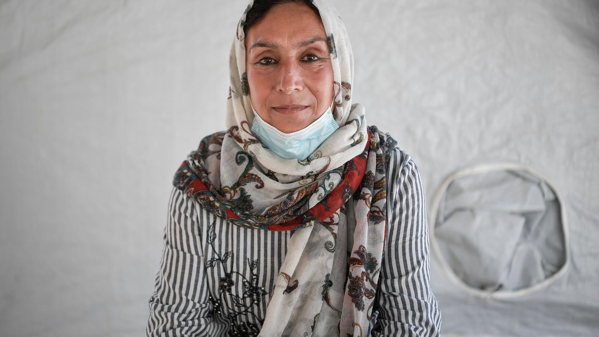 Rahima Yousofi, 45, sits inside a tent in a refugee camp on the Greek island of Lesbos
