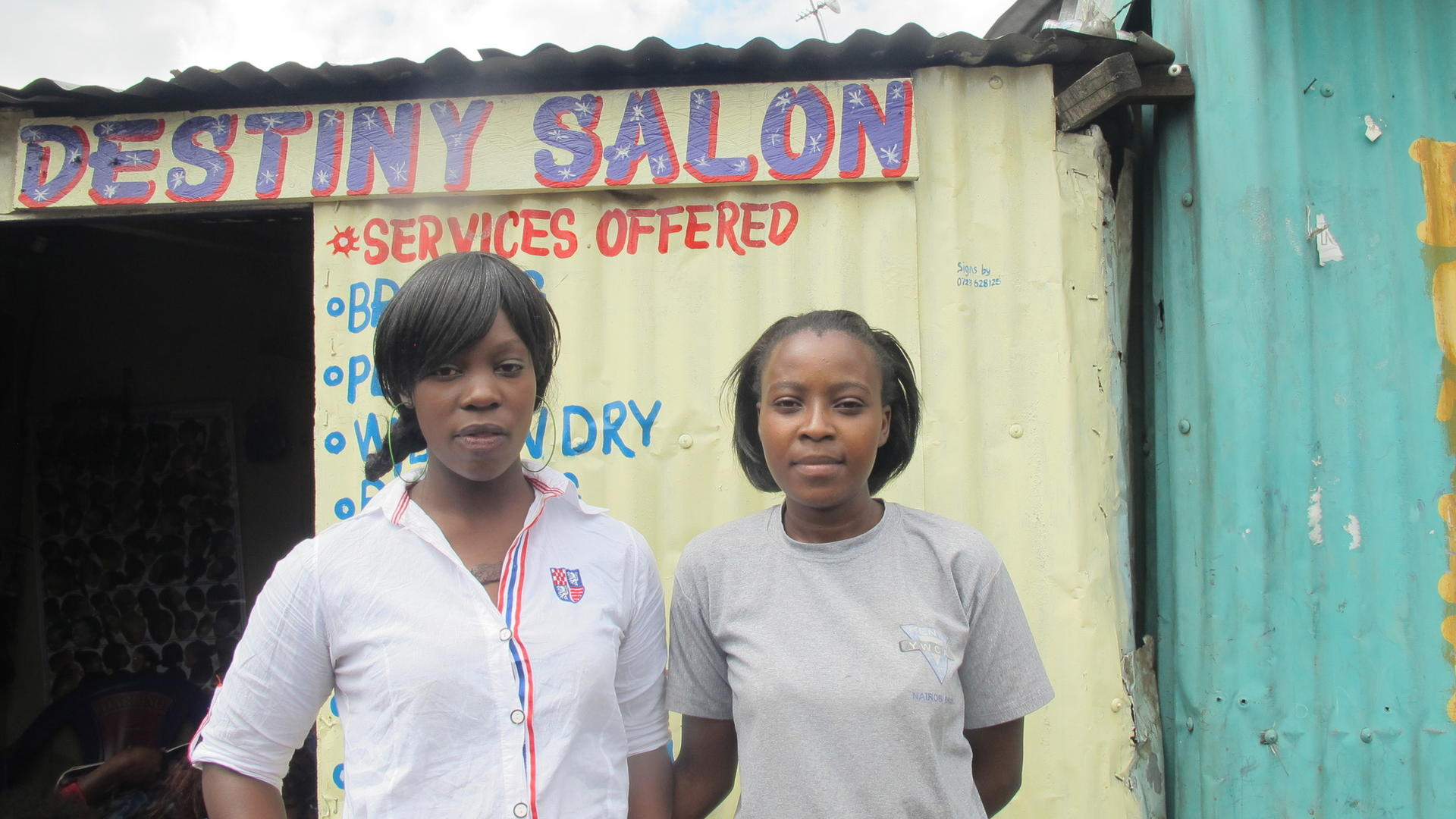Susan and partner Mariam outside Nairobi salon