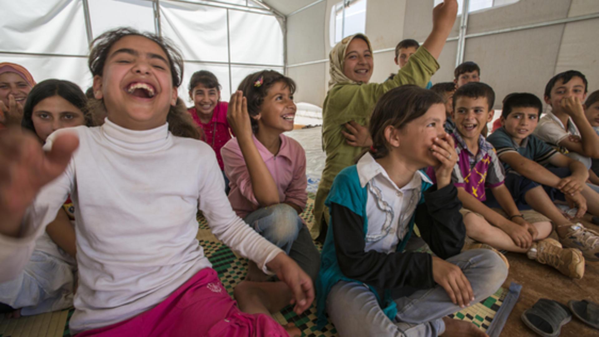 Syrian children in an IRC healing classroom tent