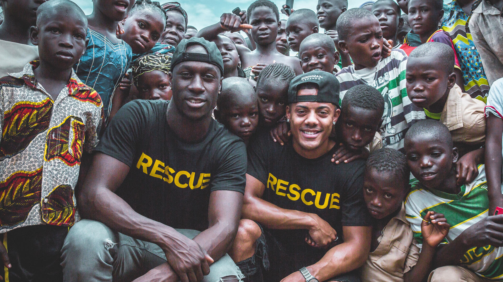 Nico & Vinz with a group of children in Ivory Coast