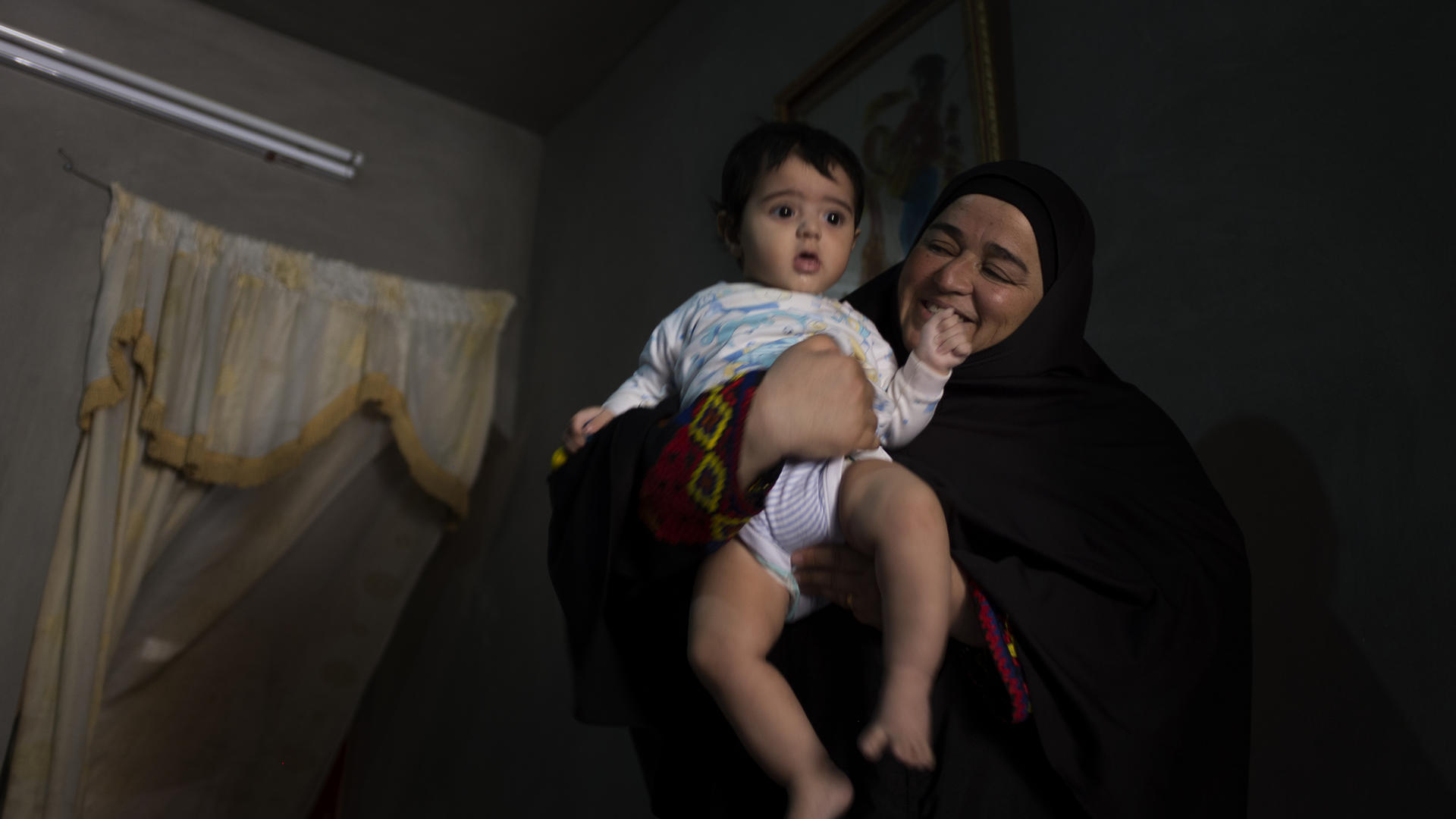Syrian woman with her young grandson in Jordan