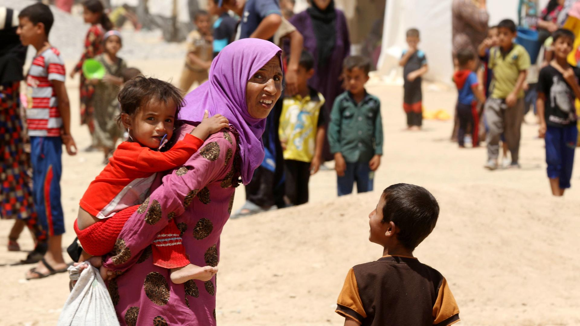 Iraqi family forced to flee home on the outskirts of Mosul to escape from ISIS violence.