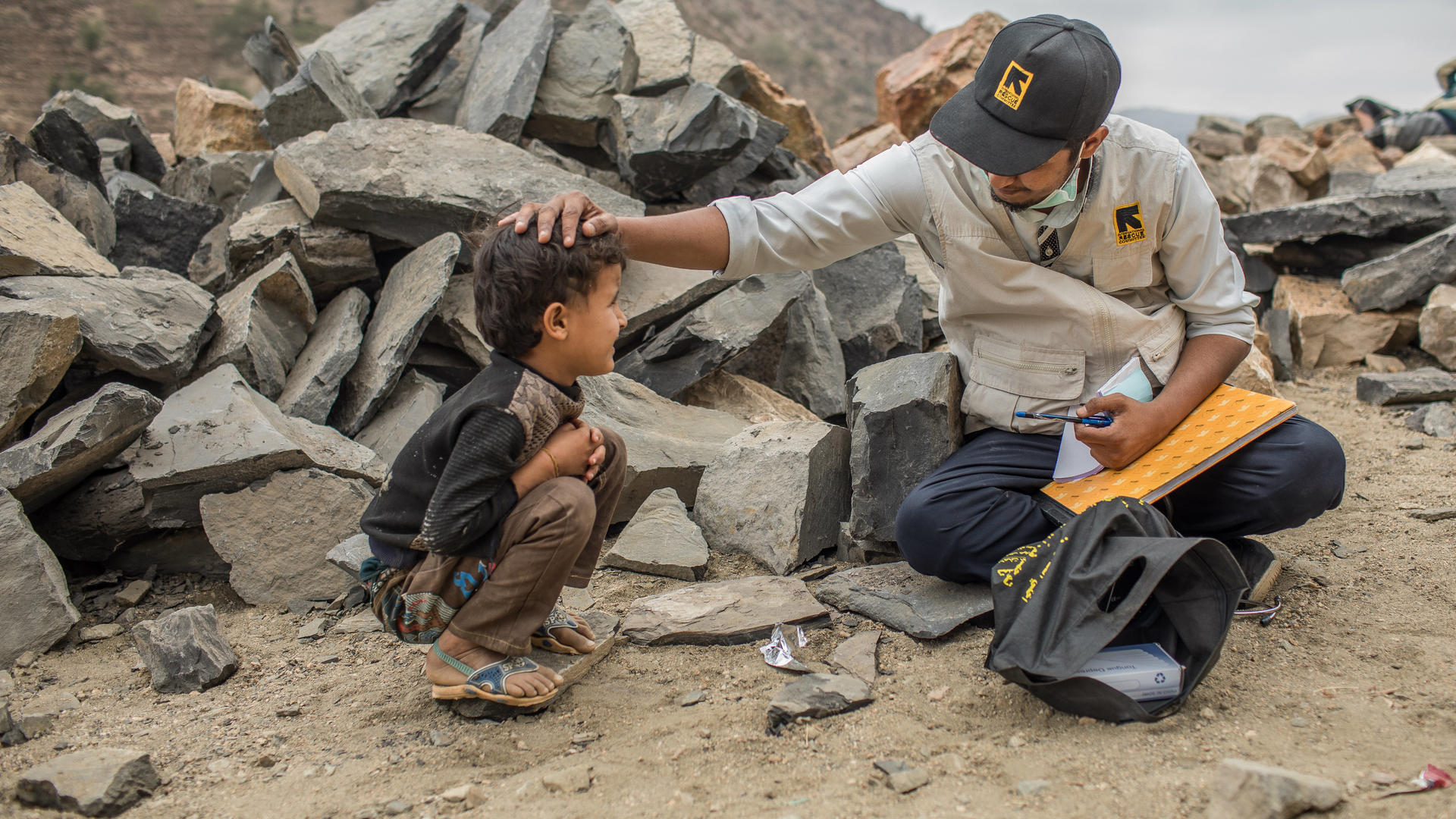 A worker from an IRC mobile health team examines a child in a remote village in Yemen