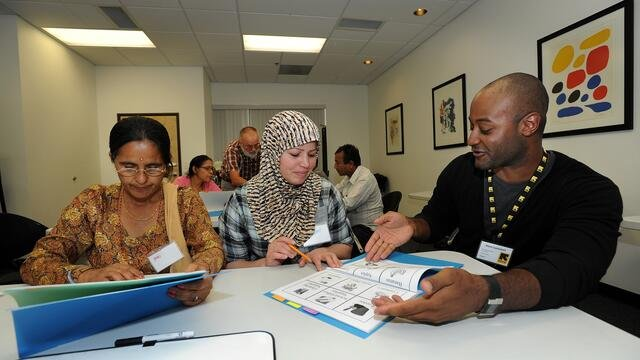 Refugees learning English as part of employment readiness training in the United States
